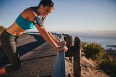 Runner leaning on road rail taking a break Stock Image