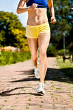 Runner legs in action Royalty Free Stock Photos