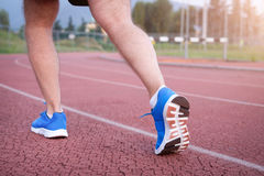 Runner legs close up on the race track red. Runner legs close up on the race track Royalty Free Stock Images