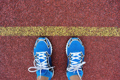 Runner legs on red running track Royalty Free Stock Photos