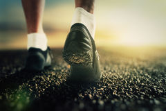 Runner legs on the road Royalty Free Stock Photo