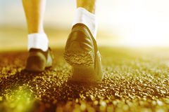 Runner legs on the road at sunrise Royalty Free Stock Image