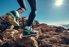 Runner legs on rocky sea line Royalty Free Stock Image