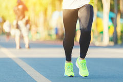 Runner legs. Runner legs between running in marathon competition in the city road Stock Images