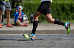 Runner legs and running shoe closeup of man, jogging outdoors Running shoes . Royalty Free Stock Photography