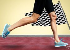 Runner legs on track against yellow background and checkered flag. Digital composite of Runner legs on track against yellow background and checkered flag Royalty Free Stock Images
