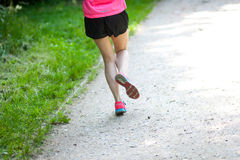 Runner legs. Young women jogging at park . Close-up photo of her legs Stock Photography