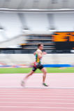 Runner at London's olympic stadium. Motion blurred athlete at the London prepares series at the Oympic park in London on May 6, 2012. The London Prepares series Royalty Free Stock Photography