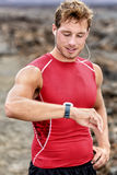 Runner looking at heart rate activity smartwatch Stock Photography