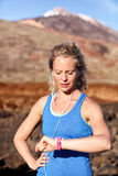 Runner looking at heart rate monitor smart watch Stock Image
