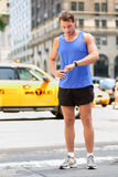 Runner looking at smart watch in New York City Stock Photography