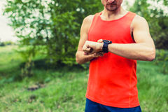 Runner looking at sport smart gps watch Royalty Free Stock Images