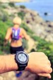 Runner looking at sport watch Stock Photos
