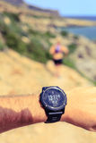 Runner looking at sport watch Royalty Free Stock Photo