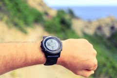 Runner looking at sport watch Stock Photography
