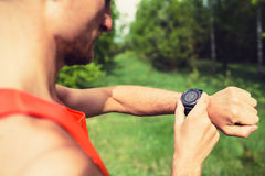 Runner looking at sport watch Stock Images