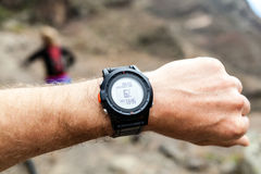 Runner looking at sport watch Royalty Free Stock Photos