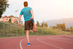 Runner making stretching on the track Stock Photos