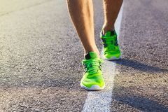 Runner man feet running on road closeup on shoe. stock photo