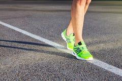 Runner man feet running on road closeup on shoe. stock photography