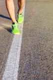 Runner man feet running on road closeup on shoe. stock image