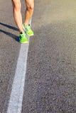 Runner man feet running on road closeup on shoe. stock photos