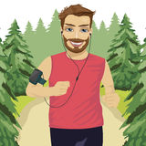 Runner man jogging in park with smartphone armband listening to music playlist on mobile phone app Royalty Free Stock Images