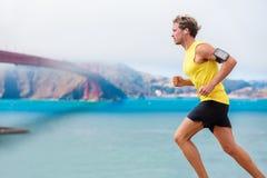 Runner man listening to music run in San Francisco Stock Photo