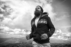 Runner man with long beard run on mountain landscape Stock Images