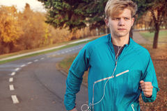 Runner man portrait in autumn park Stock Images