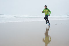 Runner man running on the beach Royalty Free Stock Photography