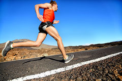 Runner man running sprinting for success on run Stock Photos