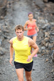 Runner man running on trail in cross-country Royalty Free Stock Photos