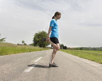 Runner man stretching Royalty Free Stock Image