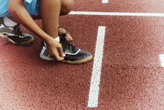 Runner man tie shoe on laces or running track Stock Images