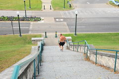 A runner on the Memphis River Fit stairway, downtown Memphis, TN. Royalty Free Stock Photo