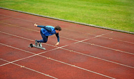 Runner Off the Starting Block. An athlete runs off the starting block Royalty Free Stock Photos