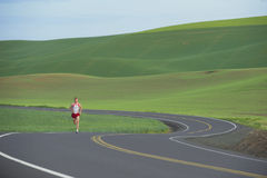 Free Runner On Rural Road Stock Photos - 9833163