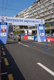 runner passes the finish line in  marathon on Apri Stock Image