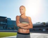 Runner practicing in athletics stadium Stock Images