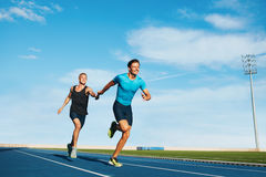 Runner practicing in athletics stadium Royalty Free Stock Photography