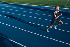 Runner practicing in athletics stadium Royalty Free Stock Images