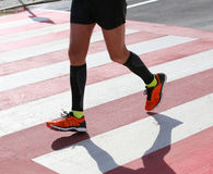 Runner during the race on the Pedestrian crossing Royalty Free Stock Images