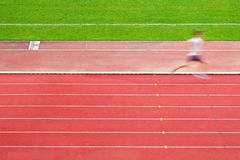 Runner in race track Stock Photography