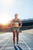 Runner on race track in athletics stadium Stock Photos