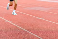 Runner on racetrack Stock Photo