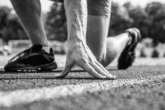 Runner ready to go close up. Ready steady go concept. At beginning of great sport career. Starting point. Hand touch. Track path close up. Hand of sportsman on royalty free stock image