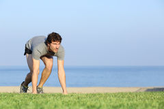 Runner ready to run on the grass Royalty Free Stock Images