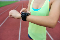 Runner ready to run set and looking at sports smart watch Royalty Free Stock Photography