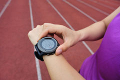 Runner ready to run set and looking at sports smart watch Royalty Free Stock Photos